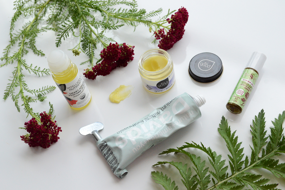 Summer travel basics for natural health on the go - davids natural toothpaste, aromatherapy stress relief serum, Intelligent Nutrients Smart Armor Bug Repellant, and All Good Goop for natural wellness wherever